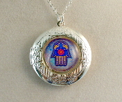 Lockets - Deep Blue Hamsa on Light Blue Background